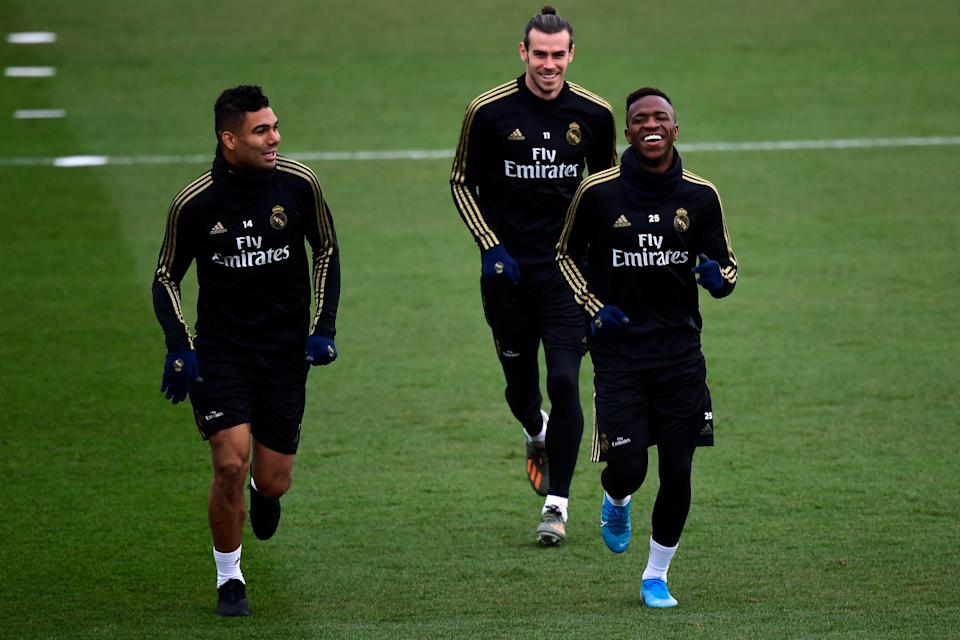 (LtoR) Real Madrid's Brazilian midfielder Casemiro, Real Madrid's Brazilian forward Vinicius Junior and Real Madrid's Welsh forward Gareth Bale attend a training session at the Real Madrid City sports facilities in Madrid on December 17, 2019, on the eve of their Spanish League football match against Barcelona FC. (Photo by JAVIER SORIANO / AFP) (Photo by JAVIER SORIANO/AFP via Getty Images)