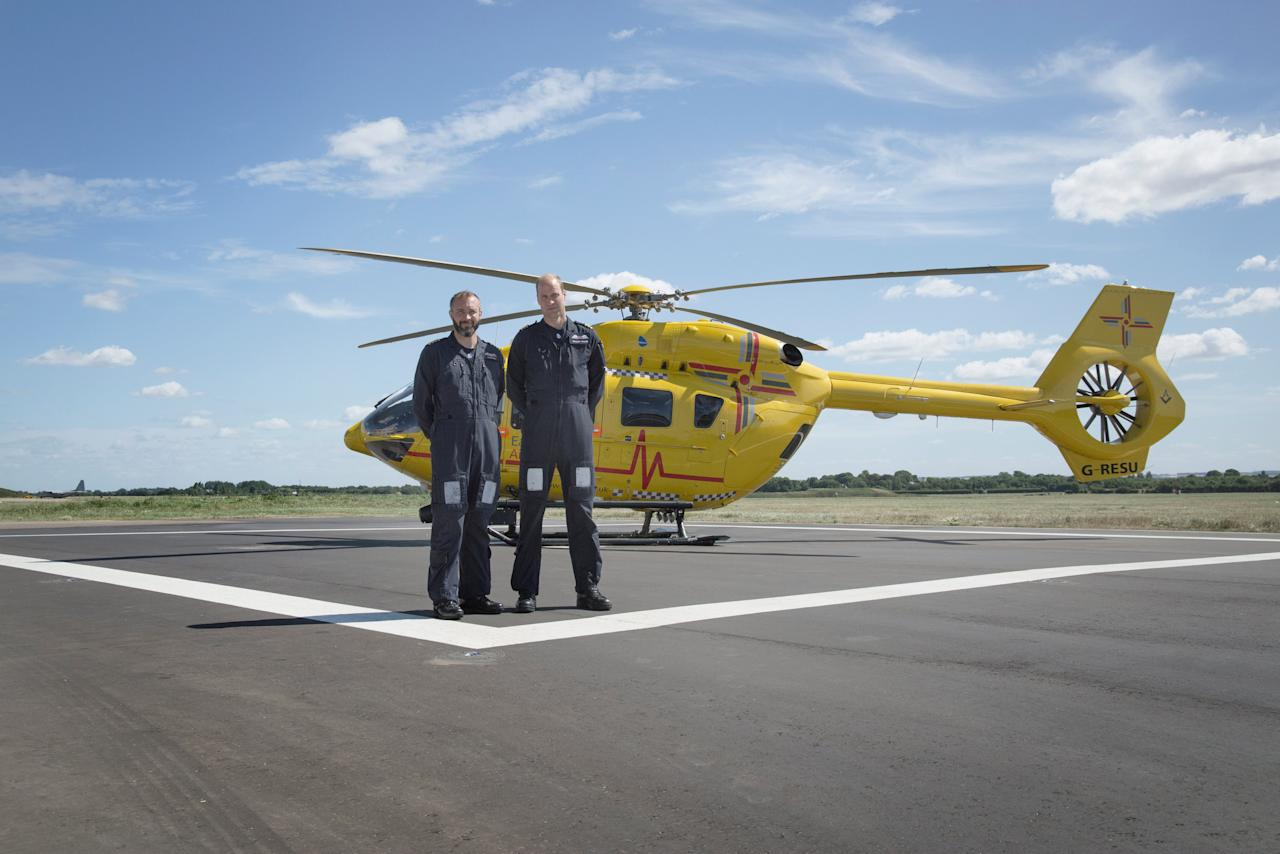 Britain's Prince William stands with Captain James Pusey in front of his East Anglian Air Ambulance (EAAA) in this photograph released in London September 20, 2016. Olivia Howitt/Courtesy of BBC/Handout via REUTERS ATTENTION EDITORS - THIS IMAGE WAS PROVIDED BY A THIRD PARTY. FOR EDITORIAL USE ONLY. NO RESALES. NO ARCHIVES.