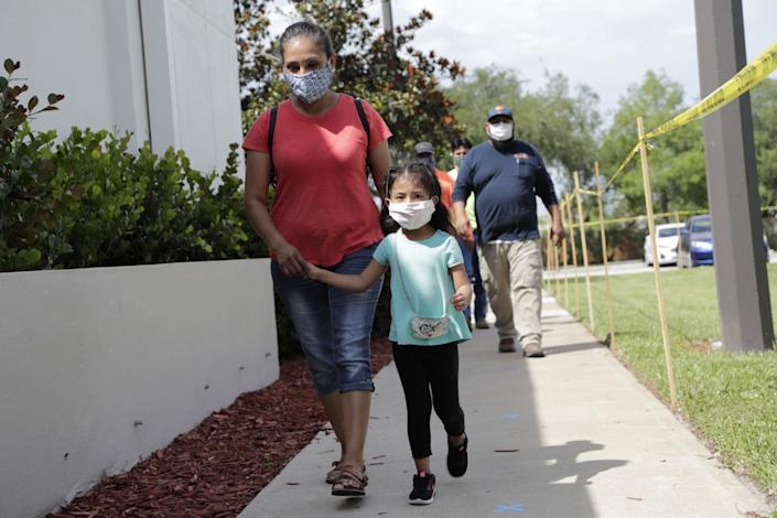 "Flora Garcia arrives with her daughter Krislaya Trejo at the Florida Department of Health in Collier County to be tested for COVID-19. <span class=""copyright"">(Lynne Sladky / Associated Press)</span>"