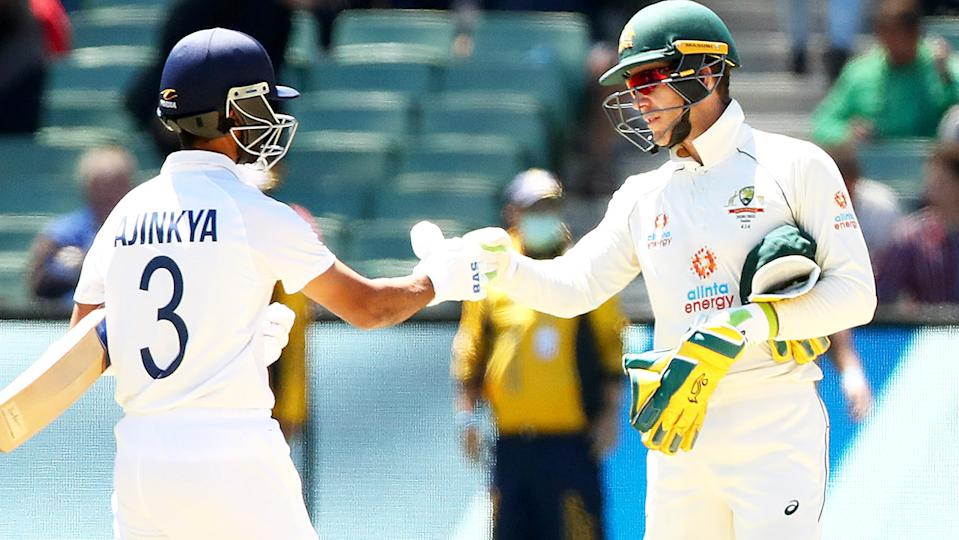 Tim Paine (pictured right) congratulates Ajinkya Rahane (pictured left) with a fist-bump.