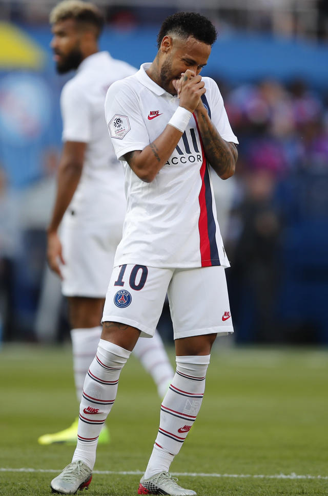 PSG's Neymar reacts during the French League One soccer match between Paris Saint Germain and Strasbourg at the Parc des Princes Stadium in Paris, France, Saturday Sept.14, 2019. (AP Photo/Francois Mori)