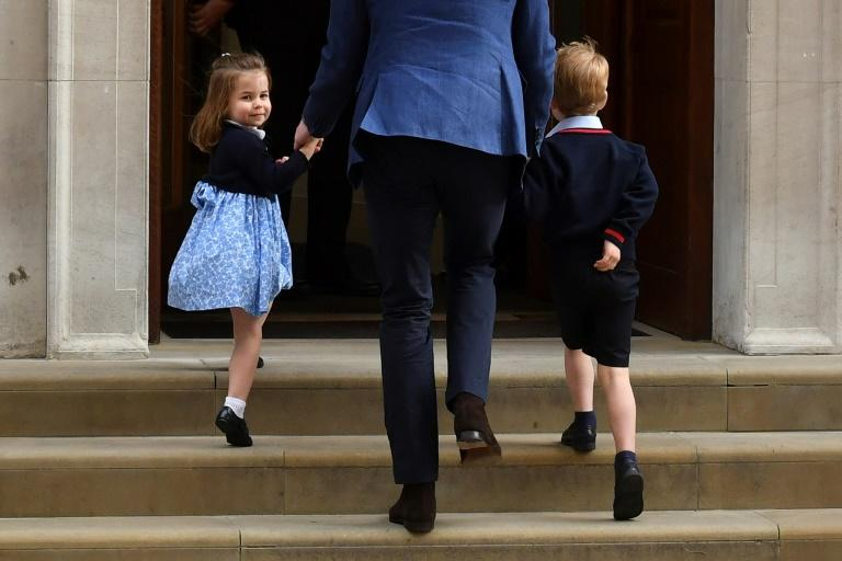 Earlier Monday Princess Charlotte (L) turned to wave at the media as she was led into the hospital with her brother Prince George (R) by their father Prince William (C) to see their mother and their new baby brother