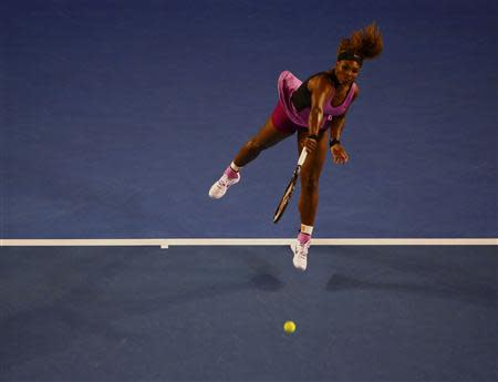 Serena Williams of the United States serves to Ashleigh Barty of Australia during their women's singles match at the Australian Open 2014 tennis tournament in Melbourne January 13, 2014. REUTERS/Petar Kujundzic