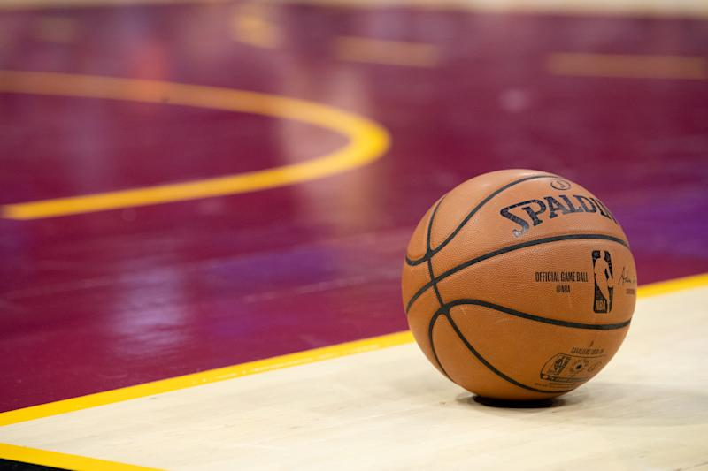 The official Spalding game basketball sits on the court between gameplay during the second half between the Cleveland Cavaliers and the Atlanta Hawks at Quicken Loans Arena on October 21, 2018 in Cleveland, Ohio. The Hawks defeated the Cavaliers 133-111. NOTE TO USER: User expressly acknowledges and agrees that, by downloading and/or using this photograph, user is consenting to the terms and conditions of the Getty Images License Agreement. (Photo by Jason Miller/Getty Images) *** Local Caption ***