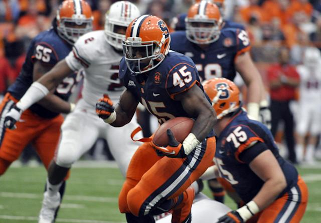 Syracuse's Jerome Smith breaks free to score a touchdown against Louisville during the third quarter of an NCAA college football game in Syracuse, N.Y., Saturday, Nov. 10, 2012. Syracuse won 45-26. (AP Photo/Kevin Rivoli)