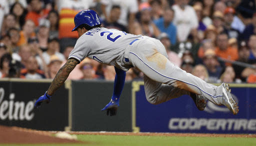 Kansas City Royals' Adalberto Mondesi slides into third after a fly-out by Whit Merrifield during the eighth inning of the team's baseball game against the Houston Astros, Friday, June 22, 2018, in Houston. (AP Photo/Eric Christian Smith)