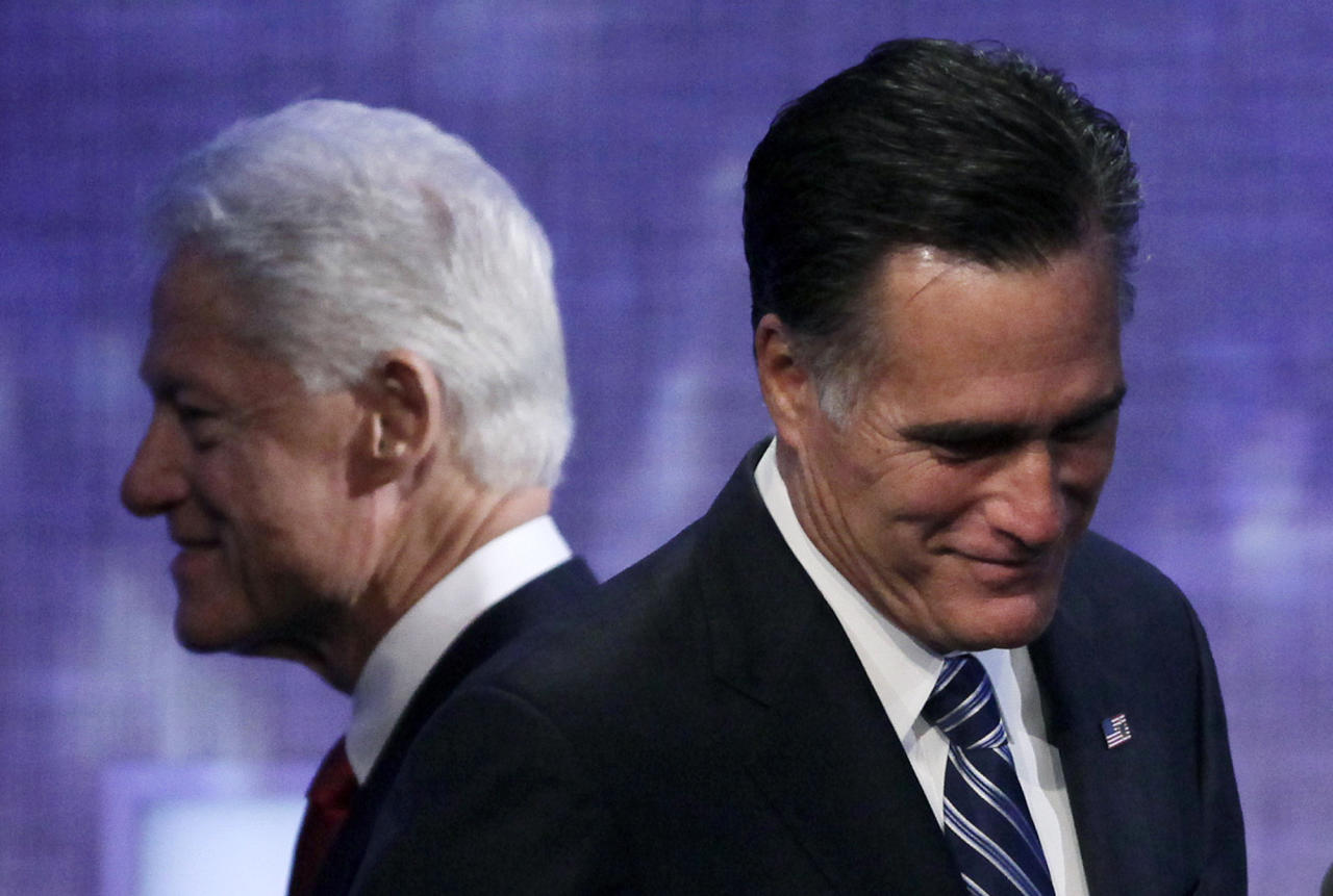Republican presidential candidate Mitt Romney steps to the podium after an introduction by former President Bill Clinton, Tuesday, Sept. 25, 2012, at the Clinton Global Initiative in New York. (AP Photo/Mark Lennihan)