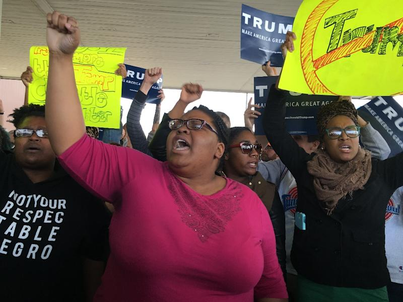 Protesters stand outside a Donald Trump rally at the International Exposition Center in Cleveland, Ohio (AFP Photo/Michael Mathes)