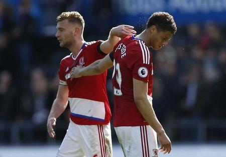 Britain Football Soccer - Swansea City v Middlesbrough - Premier League - Liberty Stadium - 2/4/17 Middlesbrough's Rudy Gestede and Ben Gibson look dejected after the match Action Images via Reuters / Andrew Boyers Livepic