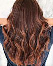 """I think <a href=""https://www.glamour.com/story/raspberry-bourbon-hair?mbid=synd_yahoo_rss"" rel=""nofollow noopener"" target=""_blank"" data-ylk=""slk:raspberry bourbon hair color"" class=""link rapid-noclick-resp"">raspberry bourbon hair color</a> is so appealing because it feels like highlights for the winter,"" <a href=""https://www.instagram.com/devin_toth/"" rel=""nofollow noopener"" target=""_blank"" data-ylk=""slk:Devon Toth"" class=""link rapid-noclick-resp"">Devon Toth</a>, hairstylist at NYC <a href=""http://www.salonsck.com/"" rel=""nofollow noopener"" target=""_blank"" data-ylk=""slk:Salon SCK"" class=""link rapid-noclick-resp"">Salon SCK</a>, tells <em>Glamour</em>. ""It's an unexpected way of brightening up your hair color during a season when people typically take their hair shade a bit darker. The depth is still there, but it melts into this bright, rustic mahogany tone. It's an evolution of the <a href=""https://www.glamour.com/story/cherry-blond-hair-color?mbid=synd_yahoo_rss"" rel=""nofollow noopener"" target=""_blank"" data-ylk=""slk:cherry hair color"" class=""link rapid-noclick-resp"">cherry hair color</a> with an added hint of purple."""