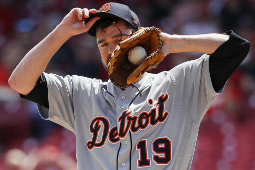 Detroit Tigers relief pitcher Louis Coleman wipes sweat from his face in the seventh inning of a baseball game against the Cincinnati Reds, Wednesday, June 20, 2018, in Cincinnati. The Reds defeated the Tigers 5-3. (AP Photo/John Minchillo)