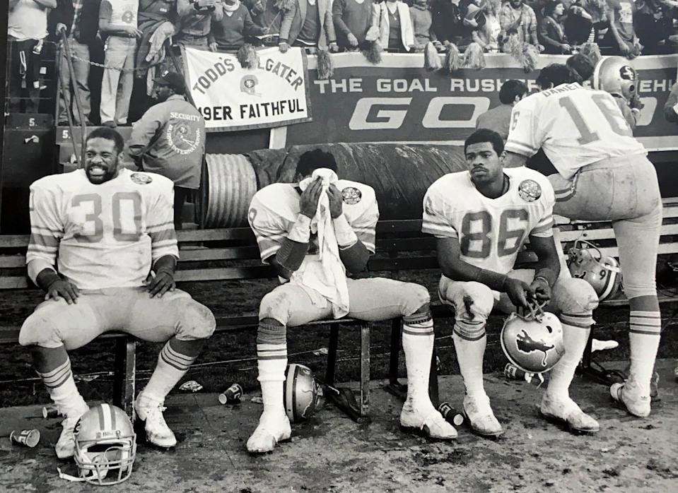 Moments after Detroit Lions kicker Eddie Murray tried but failed to kick a field goal to win the playoff game against the San Francisco 49ers in the closing seconds on Dec. 31, 1983, the offense walked off the field and reacted to losing the game. From left,  James  Jones, Leonard Thompson, Mark Nichols and Gary Danielson
