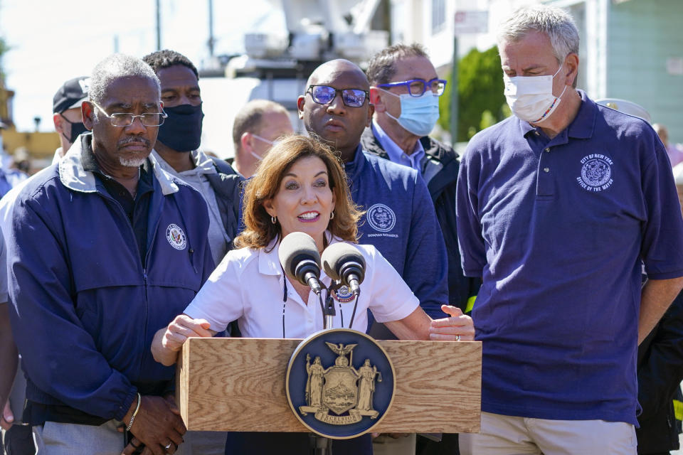 New York Gov. Kathy Hochul is joined by New York City Mayor Bill de Blasio, right, and other officials during a news conference In Queens. (Mary Altaffer/AP)