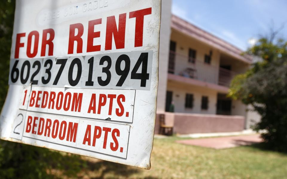 A rental sign is posted in front of an apartment complex Tuesday, July 14, 2020, in Phoenix.   (AP Photo/Ross D. Franklin)