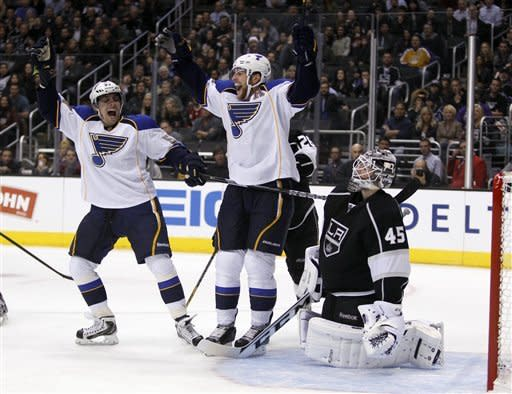 St. Louis Blues defenseman Alex Pietrangelo, center, celebrates his goal with teammate left wing David Perron, left, in front of Los Angeles Kings goalie Jonathan Bernier (45) during the first period of an NHL hockey game Tuesday, March 5, 2013, in Los Angeles. (AP Photo/Alex Gallardo)