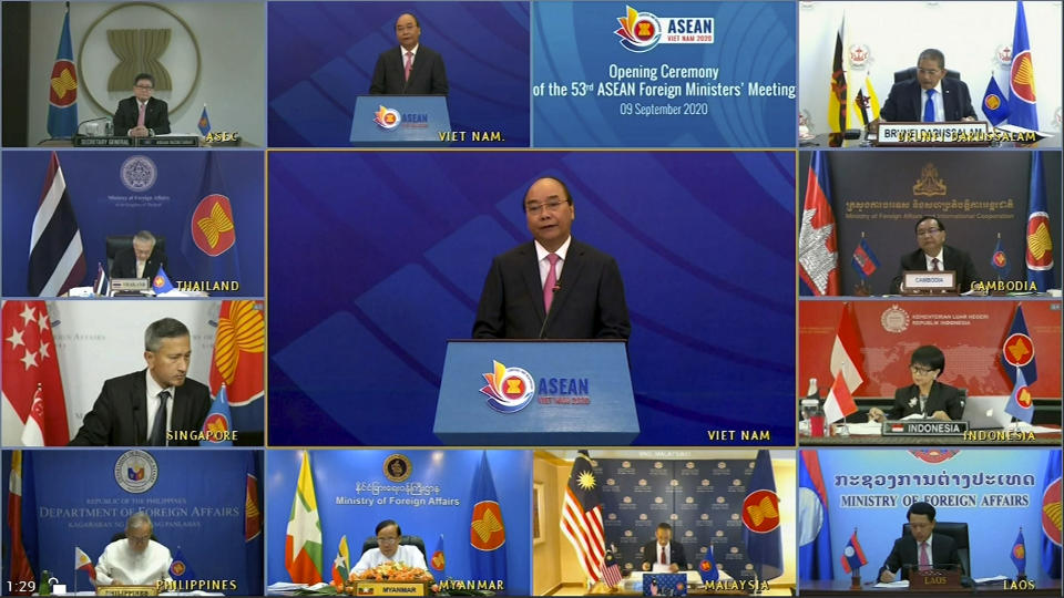 This image taken from video provided by VTV shows ASEAN foreign ministers watching Vietnamese Prime Minister Nguyen Xuan Phuc, center, delivering a speech during the opening of ASEAN Foreign Ministers' Meeting on Wednesday, Sept. 9, 2020. Southeast Asia's top diplomats are holding their annual talks by video Wednesday to discuss the immense crisis wrought by the coronavirus pandemic and rising tensions in the South China Sea amid the escalating rivalry between Washington and Beijing. (VTV via AP)