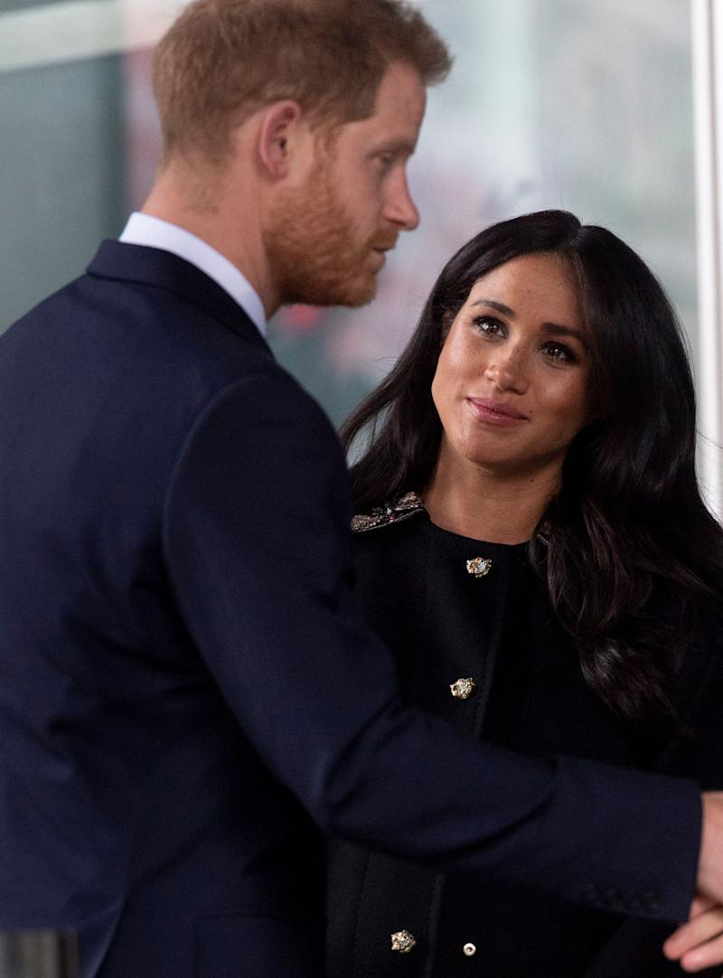 Meghan looks up at Harry during the stop on Tuesday. (Photo: Mark Cuthbert via Getty Images)