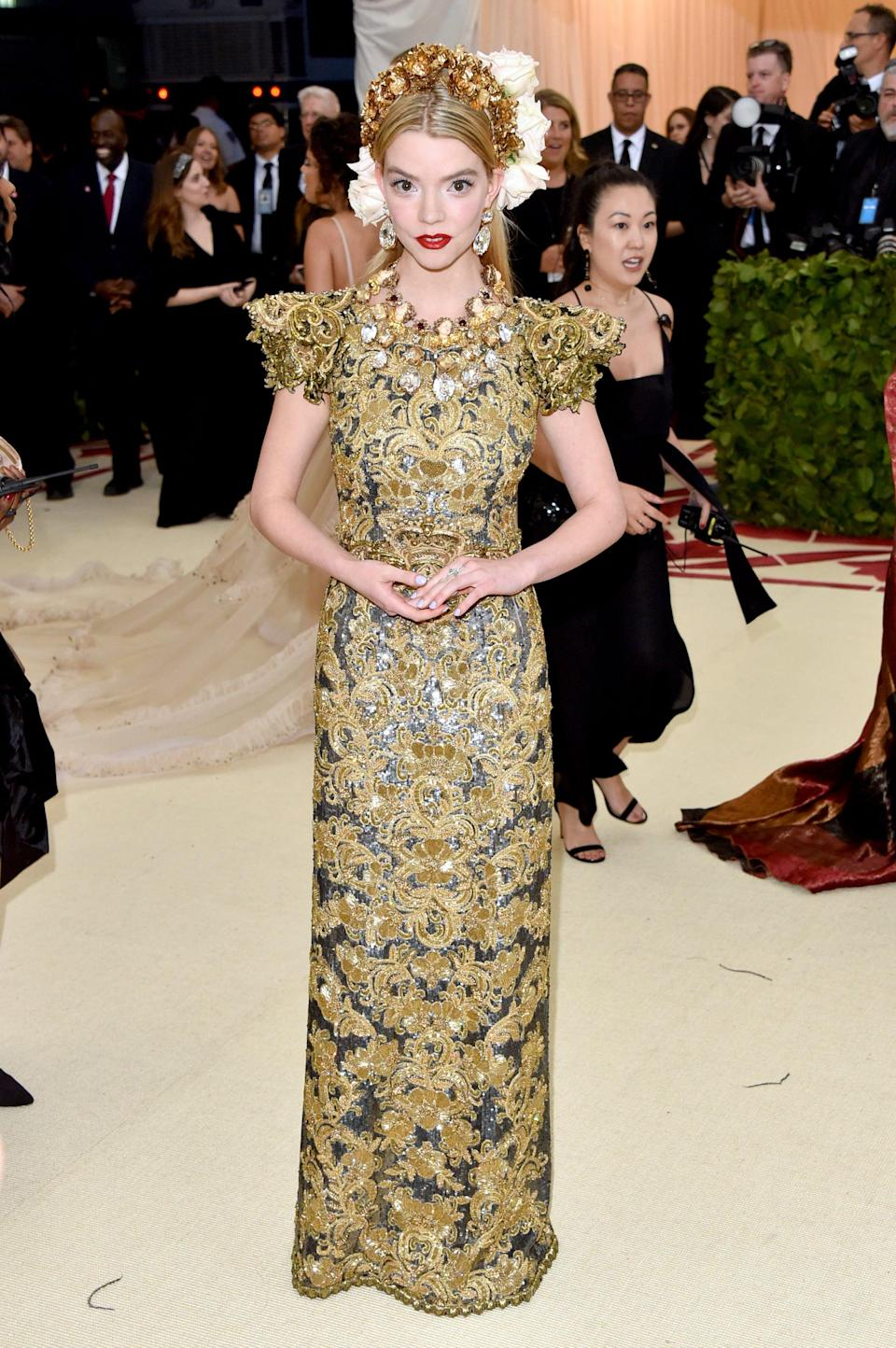 <p>Anya wore a stunning gold creation by Dolce &amp; Gabbana with matching crown.</p>