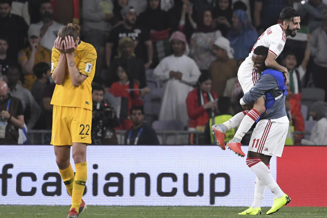 Australia's midfielder Jackson Irvine , left, holds his head after losing 1-0 to United Arab Emirates during the AFC Asian Cup quarterfinal soccer match at Hazza Bin Zayed Stadium in Al Ain, United Arab Emirates, Friday, Jan. 25, 2019. (AP Photo/Hassan Ammar)