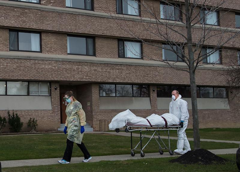 A body is wheeled from the Eatonville Care Centre in Etobicoke, Ont. during the COVID-19 pandemic on April 14, 2020. (Photo: Nathan Denette/Canadian Press)