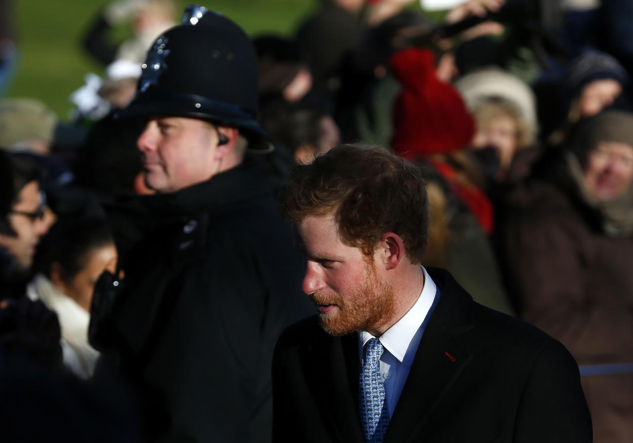 Britain's Prince Harry walks to a Christmas Day morning service at the church on the Sandringham Estate in Norfolk, eastern England, December 25, 2013. REUTERS/Andrew Winning (BRITAIN - Tags: ROYALS RELIGION)