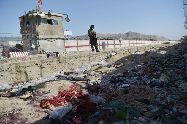 A Taliban fighter stands guard at the site of the August 26 twin suicide bombs, which killed scores of people including 13 US troops, at Kabul airport on August 27, 2021. (Photo by WAKIL KOHSAR / AFP) (Photo by WAKIL KOHSAR/AFP via Getty Images) (Photo: WAKIL KOHSAR via Getty Images)