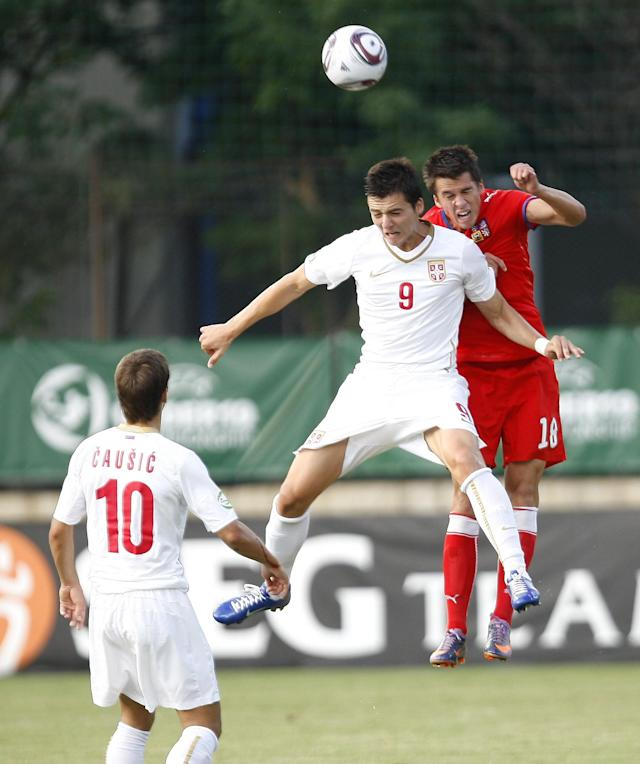 Czech's Roman Polom (R) vies with Serbia's Djordje Despotovic (C) during their final football match of the UEFA European Under-19 Championship 2010/2011 in Mogosoaia village, next to Bucharest, on July 29, 2011. AFP PHOTO / STRINGER (Photo credit should read STRINGER/AFP/Getty Images)