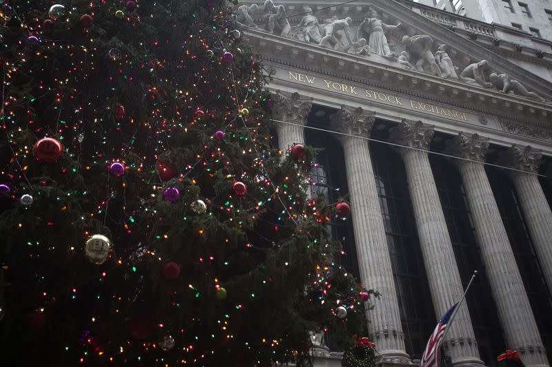 The exterior of the New York Stock Exchange is pictured with a Christmas tree in front of it in the Manhattan Borough of New York