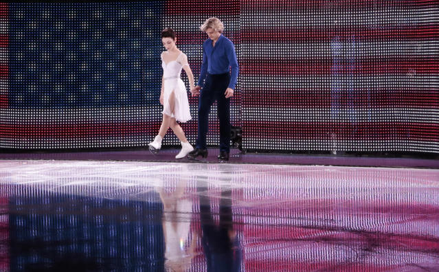 Meryl Davis and Charlie White of the United States step onto the ice before performing in the figure skating exhibition gala at the Iceberg Skating Palace during the 2014 Winter Olympics, Saturday, Feb. 22, 2014, in Sochi, Russia. (AP Photo/Ivan Sekretarev)