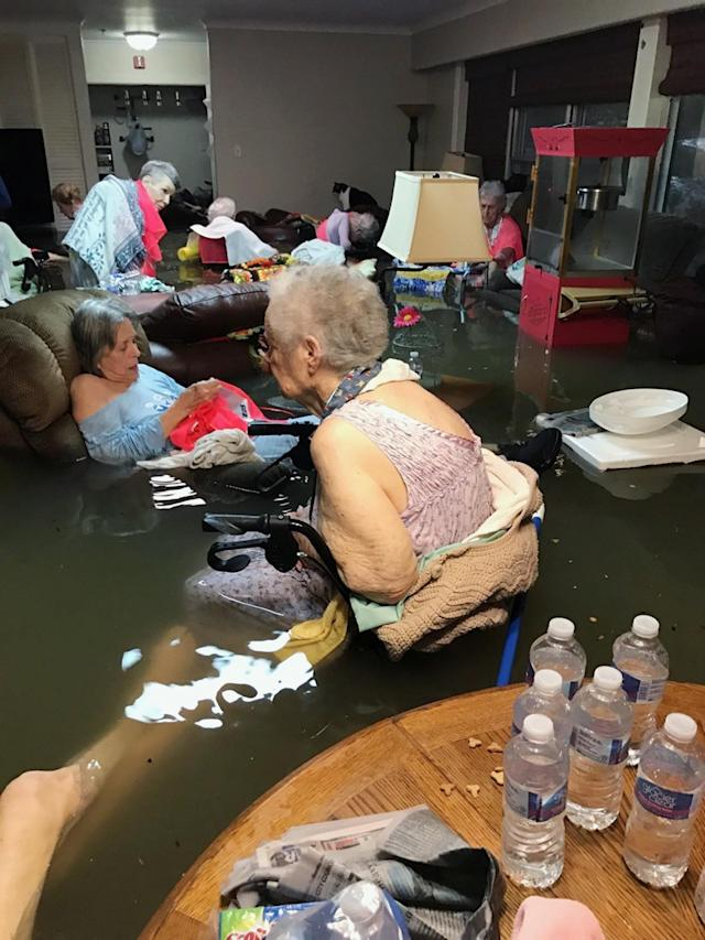 <p>In this Sunday, Aug. 27, 2017, photo provided by Trudy Lampson, residents of the La Vita Bella nursing home in Dickinson, Texas, sit in waist-deep flood waters caused by Hurricane Harvey. Authorities said all the residents were safely evacuated from the facility. (Photo: Trudy Lampson via AP) </p>