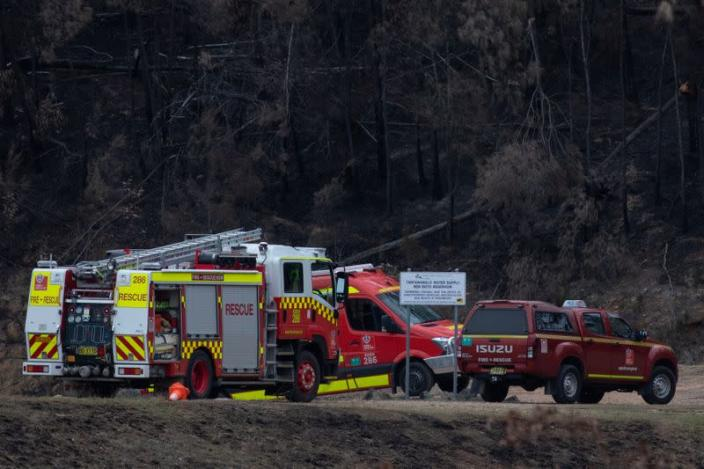 Fire rescue vehicles are seen at the Ben Boyd Reservoir following the crash of a firefighting helicopter, near Boyd Town