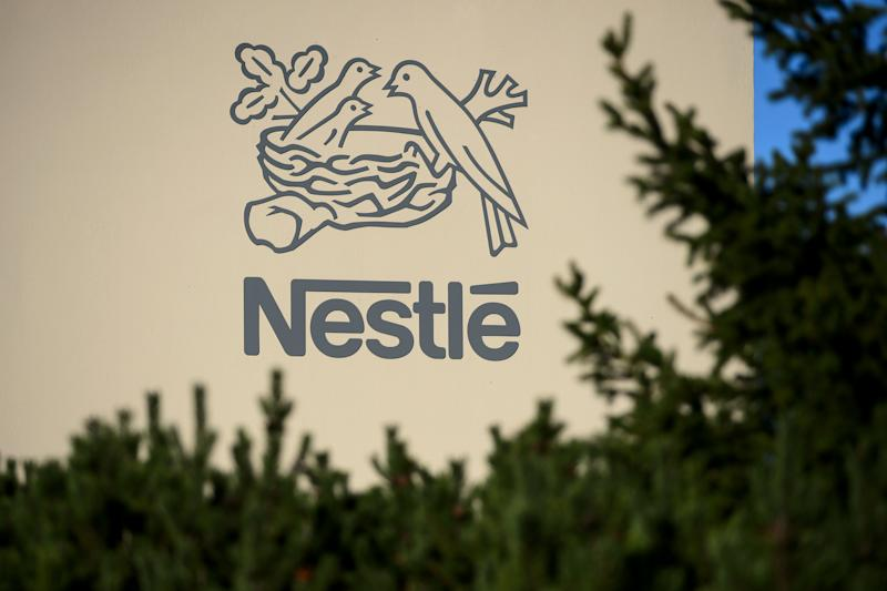 A logo of the world's leading food industry group Nestle is seen on October 9, 2014 at the group's Research Center in Vers-chez-les-Blanc above Lausanne. AFP PHOTO / FABRICE COFFRINI (Photo credit should read FABRICE COFFRINI/AFP/Getty Images)