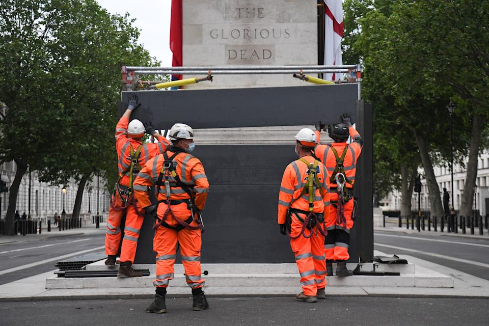 Scaffolders erect boarding around the Cenotaph on Whitehall, London, following a raft of Black Lives Matter protests that took place across the UK over the weekend. The protests were sparked by the death of George Floyd, who was killed on May 25 while in police custody in the US city of Minneapolis. (Photo by Kirsty O'Connor/PA Images via Getty Images)