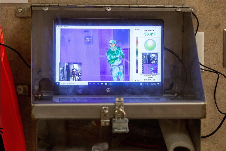 This April 28, 2020 photo shot in Sprinngdale, Ark., and provided by Tyson Foods shows one of the 150 thermal temperature scanners the company has installed at its meat processing plants to check employee temperatures as they enter. Checking for fevers before workers enter the plant is one of the steps the industry says it has taken to help limit the spread of the coronavirus.(Beth Hall/Tyson Foods via AP)