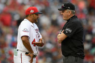 FILE - In this April 28, 2018, file photo, Washington Nationals manager Dave Martinez, left, talks with second base umpire Mike Everitt during a pitching change in the 10th inning of the team's baseball game against the Arizona Diamondbacks in Washington. Major League Baseball will start each extra inning this season by putting a runner on second base. This rule has been used since 2018 in the minor leagues, where it created more action and settled games sooner. I havent met anyone so far that likes it, Martinez said. (AP Photo/Nick Wass, File)