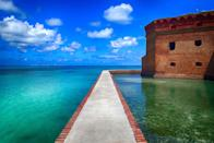 """<p><a href=""""https://www.nps.gov/drto/index.htm"""" rel=""""nofollow noopener"""" target=""""_blank"""" data-ylk=""""slk:Dry Tortugas National Park"""" class=""""link rapid-noclick-resp""""><strong>Dry Tortugas National Park </strong></a></p><p>The Everglades are enormous and cover much of the Southern part of Florida and should definitely be on your list, but if you are looking for a completely unique and cool National Park experience, this one is it. In order to get to Fort Jefferson, you have to take a ferry (that runs once a day) from Key West, or find a seaplane, and head hours out into the middle of the Gulf of Mexico. Once at the fort you can explore the grounds and snorkel along the crystal clear coral reef and see everything from sharks to sea turtles. </p>"""