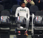Injured Milwaukee Bucks forward Giannis Antetokounmpo watches from the bench as his team takes on the Atlanta Hawks in Game 5 of the Eastern Conference finals in the NBA basketball playoffs Thursday, July 1, 2021, in Milwaukee. (Curtis Compton/Atlanta Journal-Constitution via AP)