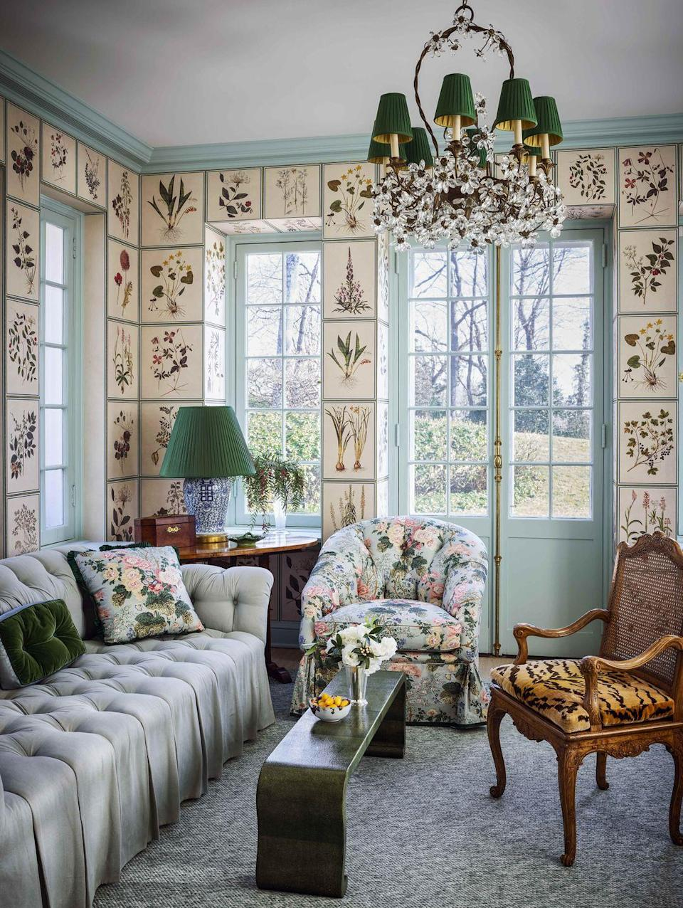 "<p> Miles Redd brought <a href=""https://www.veranda.com/decorating-ideas/house-tours/a34244489/miles-redd-greenwich-house-tour/"" rel=""nofollow noopener"" target=""_blank"" data-ylk=""slk:this Connecticut home"" class=""link rapid-noclick-resp"">this Connecticut home</a>'s office space to life with baby blues, verdant greens, and surprising pops of pattern. A gridded wallpaper by Iskel, a blooming chandelier, and Lee Jofa fabric for the chair and matching throw pillow make the space feel less office and more sunroom.. This comfortable, lush space is as ideal to work in as it is for an afternoon cat-nap.</p>"