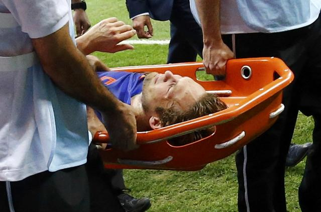 Daley Blind of the Netherlands is carried off the pitch after being injured during their 2014 World Cup third-place playoff against Brazil at the Brasilia national stadium in Brasilia July 12, 2014. REUTERS/Dominic Ebenbichler (BRAZIL - Tags: SOCCER SPORT WORLD CUP)