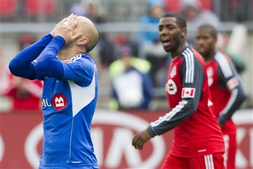 Montreal Impact's Marco Di Vaio, left, reacts after missing a last minute goal scoring opportunity against Toronto FC during second half MLS action in Toronto on Saturday Oct. 20, 2012. (AP Photo/The Canadian Press, Chris Young)
