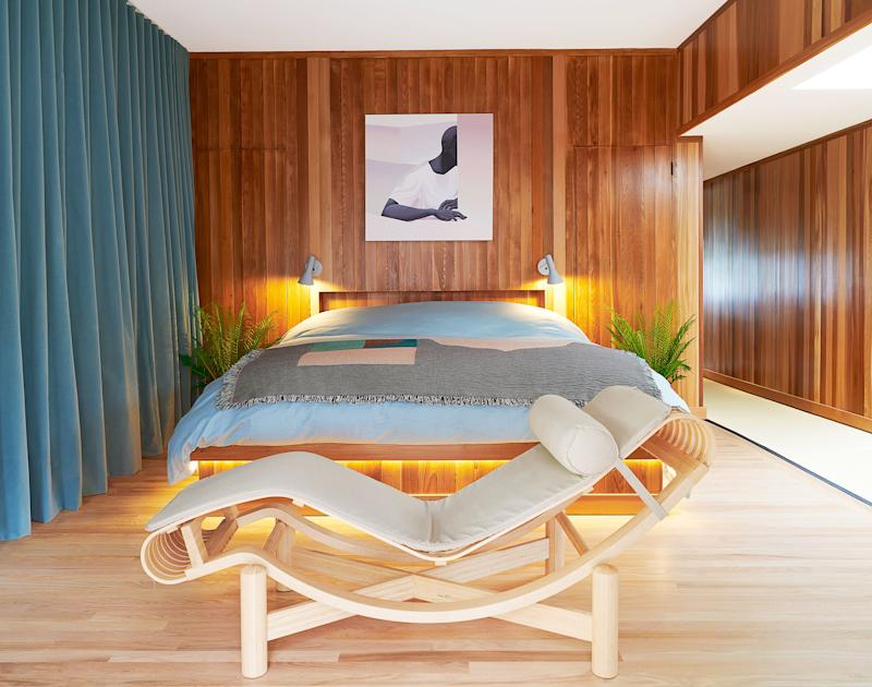 A Charlotte Perriand chaise longue anchors the master bedroom.