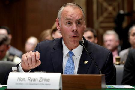 FILE PHOTO: U.S. Interior Secretary Ryan Zinke testifies before a Senate Appropriations Interior, Environment and Related Agencies Subcommittee hearing on the FY2019 funding request and budget justification for the Interior Department, on Capitol Hill in Washington, U.S., May 10, 2018. REUTERS/Yuri Gripas/File Photo