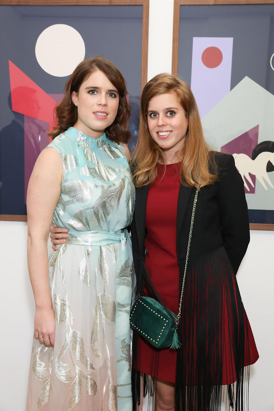 LONDON, ENGLAND - MAY 22: HRH Princess Eugenie of York (L) and HRH Princess Beatrice of York at the Animal Ball Art Show Private Viewing, presented by Elephant Family on May 22, 2019 in London, England. (Photo by David M. Benett/Dave Benett/Getty Images for Animal Ball)