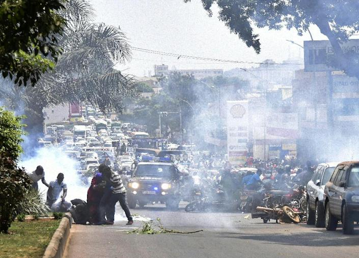 Ugandan police fire tear gas in Kampala on February 15, 2016 to disperse opposition supporters (AFP Photo/Isaac Kasamani)