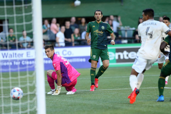 Portland Timbers midfielder Diego Valeri (8) scores his 100th MLS goal, early in the first half against Los Angeles FC during an MLS soccer match Wednesday, July 21, 2021, in Portland, Ore. (Sean Meagher/The Oregonian via AP)