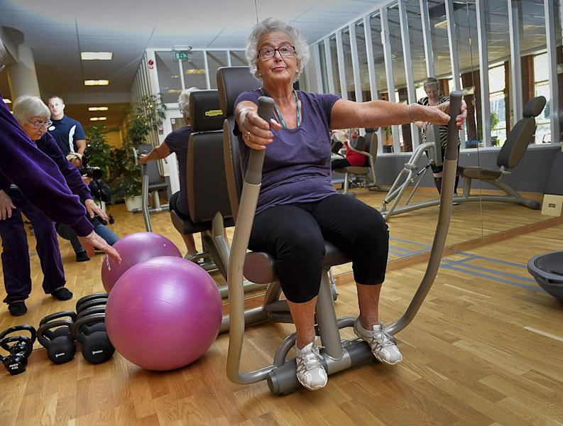 In this Sept. 26, 2013 photo, 80-year-old Marianne Blomberg works out at a gym in Stockholm. Much of the world is not prepared to support the ballooning population of elderly people, including many of the fastest-aging countries, according to a global study scheduled to be released Tuesday, Oct. 1, by the United Nations and an elder rights group. The Swedish government has suggested people continue working beyond 65, a prospect Blomberg cautiously welcomes but warns should not be a requirement. (AP Photo/TT News Agency, Jonas Ekstromer)