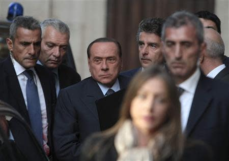 Italy's former PM Berlusconi arrives at the lower house of parliament in Rome