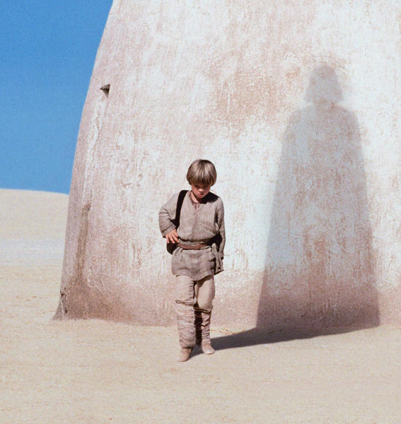"FILE - In this publicity photo released by Lucasfilm Ltd., actor Jake Lloyd portrays Anakin Skywalker, a young Darth Vader, in ""Star Wars: Episode I, The Phantom Menace."" Walt Disney Co. CEO Bob Iger says screenwriters Larry Kasdan and Simon Kinberg are both working on standalone ""Star Wars"" movies not part of a new planned trilogy. Iger told CNBC on Tuesday, Feb. 5, 2013, that the standalone movies will be based on ""great 'Star Wars' characters that are not part of the overall saga."" (AP Photo/Lucasfilm Ltd., file)"
