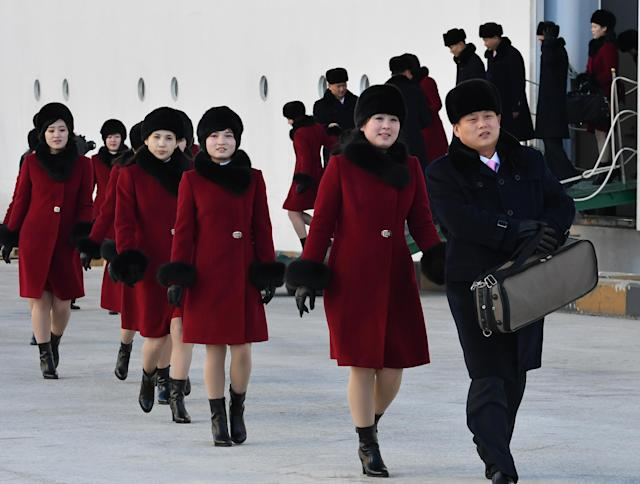 A delegation of North Korean cheerleaders arrive in South Korea ahead of the 2018 Winter Olympics in PyeongChang. (Getty)