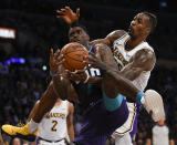 Charlotte Hornets guard Dwayne Bacon, left, and Los Angeles Lakers center Dwight Howard battle for the rebound during the second half of an NBA basketball game in Los Angeles, Sunday, Oct. 27, 2019. The Lakers won 120-101. (AP Photo/Kelvin Kuo)